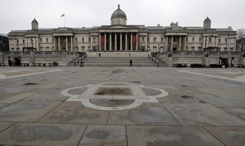 One of London's tourist hot spots, Trafalgar Square, is nearly abandoned in London, Thursday, March 19, 2020. For most people, the new coronavirus causes only mild or moderate symptoms, such as fever and cough. For some, especially older adults and people with existing health problems, it can cause more severe illness, including pneumonia.(AP Photo/Frank Augstein)