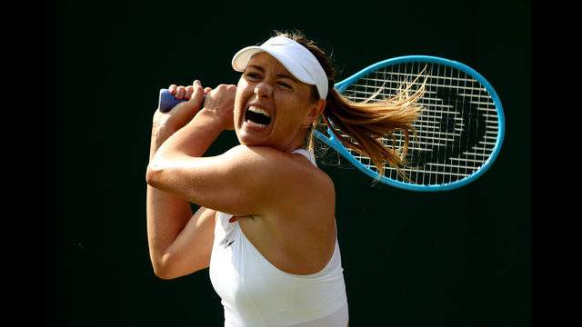 LONDON, ENGLAND - JULY 02: Maria Sharapova of Russia plays a forehand in her Ladies' Singles first round match against Pauline Parmentier of France during Day two of The Championships - Wimbledon 2019 at All England Lawn Tennis and Croquet Club on July 02, 2019 in London, England. (Photo by Clive Brunskill/Getty Images)