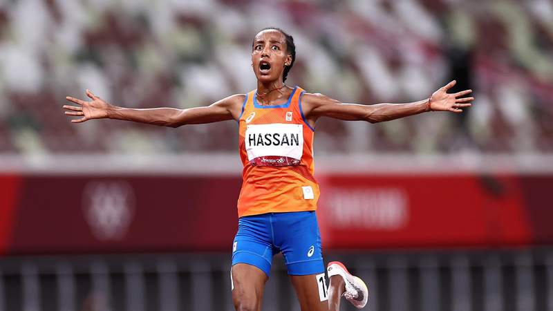 TOKYO, JAPAN - AUGUST 07: Sifan Hassan of Team Netherlands celebrates as she wins the gold medal in the Women's 10,000m Final on day fifteen of the Tokyo 2020 Olympic Games at Olympic Stadium on August 07, 2021 in Tokyo, Japan. (Photo by Ryan Pierse/Getty Images)