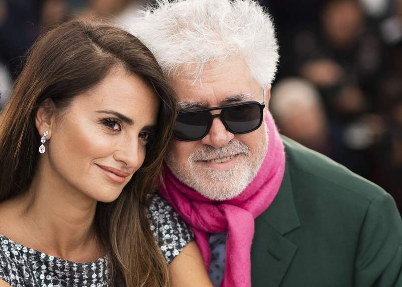 """FILE - Actress Penelope Cruz, left, and director Pedro Almodovar pose for photographers at the photo call for the film """"Pain and Glory"""" at the 72nd international film festival, Cannes, southern France, on May 18, 2019.  The Venice Film Festival is kicking off its 78th edition on Sept. 1, 2021, on the Lido with the premiere of Almodvars Madres Paralelas, starring Cruz. (Photo by Arthur Mola/Invision/AP, File)"""