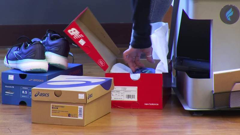 Fleet Feet donate shoes to kids in need
