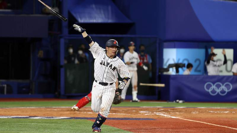 Takuya Kai of Japan reacts after hitting a game-winning single in the tenth inning to defeat  the United States 7-6 during the knockout stage of the Olympic baseball tournament.