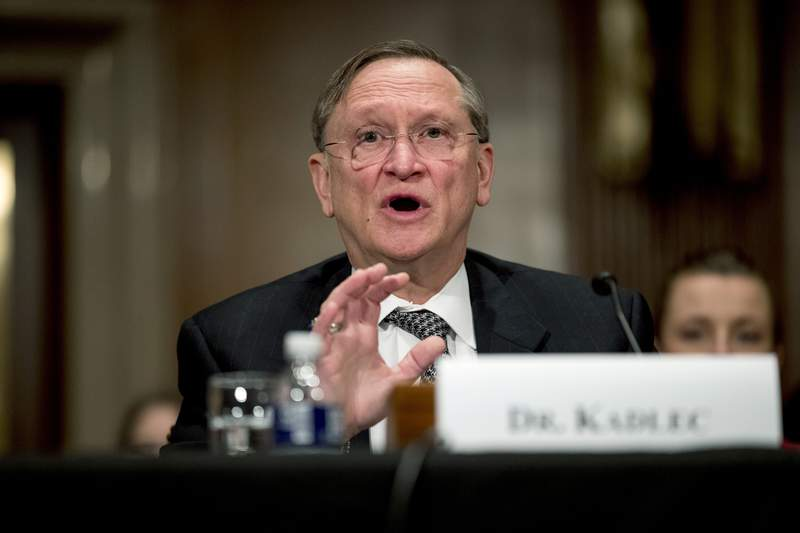 """FILE - In this March 3, 2020 file photo, Health and Human Services Assistant Secretary for Preparedness and Response Dr. Robert Kadlec testifies before a Senate Education, Labor and Pensions Committee hearing on the coronavirus on Capitol Hill in Washington. Kadlec said in an email Friday, Oct. 9, that the Trump administration is accelerating production of safe and effective vaccines ... to ensure delivery starting January 2021."""" (AP Photo/Andrew Harnik)"""