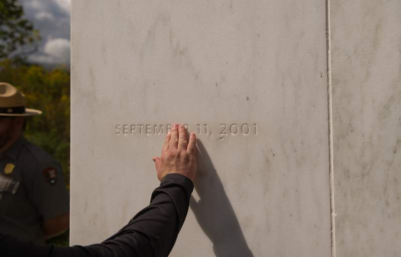 A visitor traces the date etched in a marble slab on the Wall of Names at the Flight 93 National Memorial before the 15th anniversary of the Sept. 11 terrorist attacks.