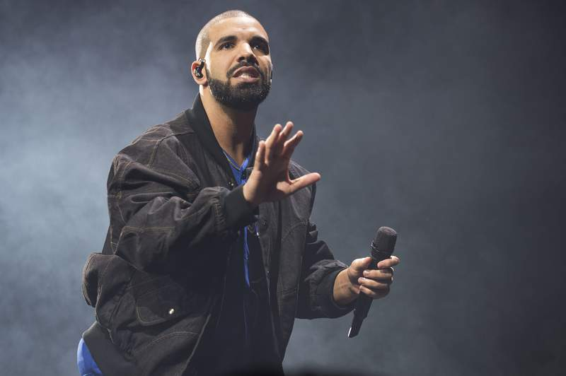 FILE - In this Oct. 8, 2016 file photo, Drake performs onstage in Toronto. The rapper has been named Spotifys most-streamed artist of the decade. (Photo by Arthur Mola/Invision/AP, File)
