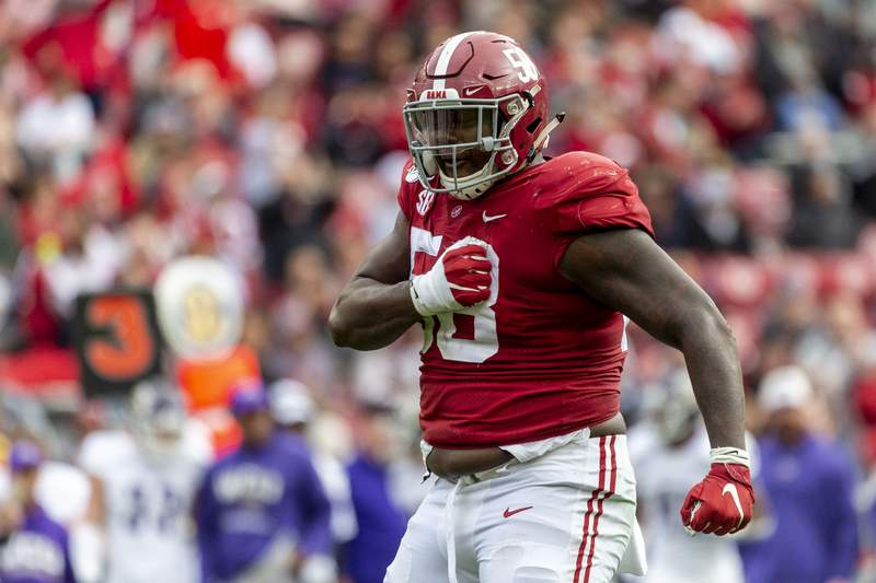 FILE - Alabama defensive lineman Christian Barmore (58) celebrates a sack against Western Carolina during the first half of an NCAA college football game in Tuscaloosa, Ala., in this Saturday, Nov. 23, 2019, file photo. Cleveland Browns veteran defensive tackle Sheldon Richardson's surprise release last week due to salary-cap concerns has created an unexpected hole up front. Alabama's Christian Barmore could fill it. (AP Photo/Vasha Hunt, File)