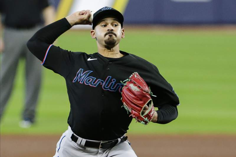 Miami Marlins' Pablo Lopez delivers a pitch during the second inning in Game 2 of a baseball National League Division against the Atlanta Braves Series Wednesday, Oct. 7, 2020, in Houston. (AP Photo/Michael Wyke)