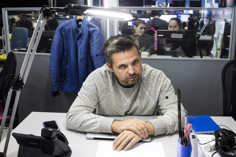 Roman Badanin, chief editor of the Proekt investigative online outlet sits at a working p[lace in Moscow, Russia, Thursday, Oct. 6, 2016. Russian authorities on Tuesday morning raided the apartments of several investigative journalists and their family members, a move that comes amid mounting pressure on Russia's independent media outlets. (AP Photo/Evgeny Feldman)