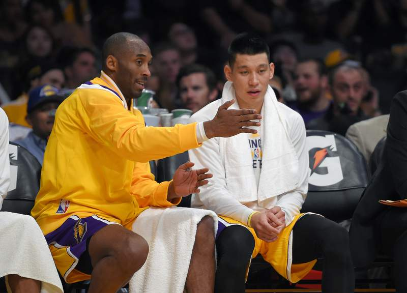 FILE - In this Wednesday, Nov. 26, 2014 file photo, Los Angeles Lakers guard Kobe Bryant, left, talks with guard Jeremy Lin during the first half of an NBA basketball game against the Memphis Grizzlies in Los Angeles. For the G League Ignite, it was a beginning. For Jeremy Lin, it may be a new beginning. Hes one of the former NBA players in the G League bubble at Walt Disney World in Lake Buena Vista, Florida this month, as part of the Santa Cruz Warriors. (AP Photo/Mark J. Terrill, File)