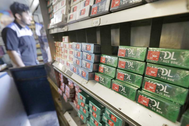 FILE - This May 17, 2018 file photo shows packs of menthol cigarettes and other tobacco products at a store in San Francisco. U.S. health regulators will announce a new effort Thursday, April 29, 2021, to ban menthol cigarettes, according to an Biden administration official. (AP Photo/Jeff Chiu, File)