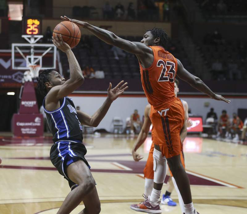 Virginia Tech's Tyrece Radford (23) blocks a shot by Dukes's Jeremy Roach (3) in the second half of an NCAA college basketball game in Blacksburg, Va., Tuesday January12 2021. Virginia Tech won the game 74-67. (Matt Gentry/The Roanoke Times via AP, Pool)