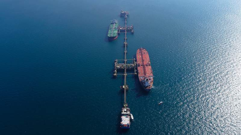 An aerial photo shows oil tankers load crude oil at Iraq's Al-Basra Offshore Terminal in Basra, Iraq, Sunday, Dec. 27, 2020. (AP Photo/Nabil al-Jurani)