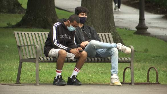 Two students wear masks on Virginia Tech's campus.