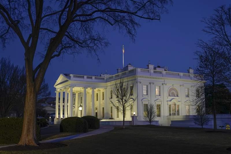 Dusk settles over the White House in Washington, Saturday, Jan. 23, 2021. (AP Photo/Patrick Semansky)