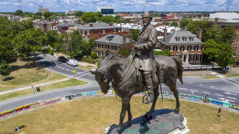 FILE - This July 10, 2020 file photo shows the statue of Confederate General Robert E. Lee is the only Confederate monument left on on Monument Avenue in Richmond, Va. A judge on Tuesday, Aug. 18, 2020 will weigh whether to dismiss a lawsuit seeking to prevent Virginia's Democratic governor from removing the  statue of Lee on Monument Avenue. (AP Photo/Steve Helber)