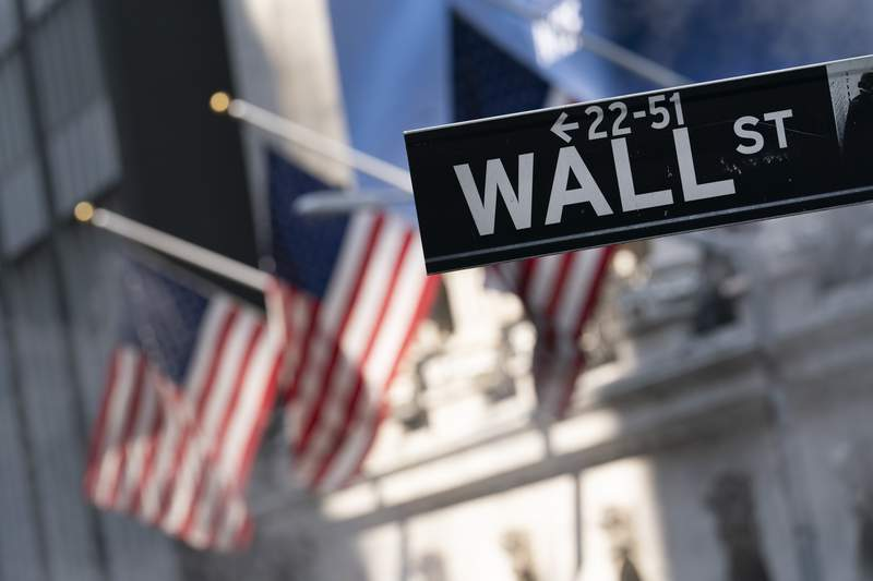 FILE -A sign for Wall Street hangs in front of the New York Stock Exchange, July 8, 2021.  Stocks rose in morning trading on Wall Street Thursday, Sept. 30,  after U.S. lawmakers moved to avert a government shutdown, but the major indexes are still on track for monthly losses.(AP Photo/Mark Lennihan, file)