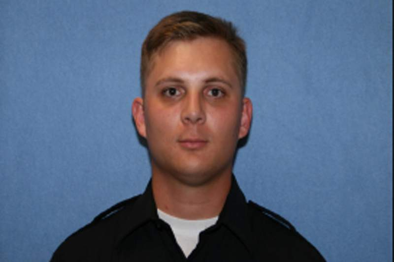 In this undated photo provided by the Phoenix Police Department is Officer Ginarro New. The Phoenix police officer died after being hit by a driver who ran a red light and also died, authorities said Tuesday, June 1, 2021. The crash happened Monday night after 27-year-old Officer New entered an intersection and his police SUV was hit by another car, Phoenix police said in a statement. (Phoenix Police Department via AP)