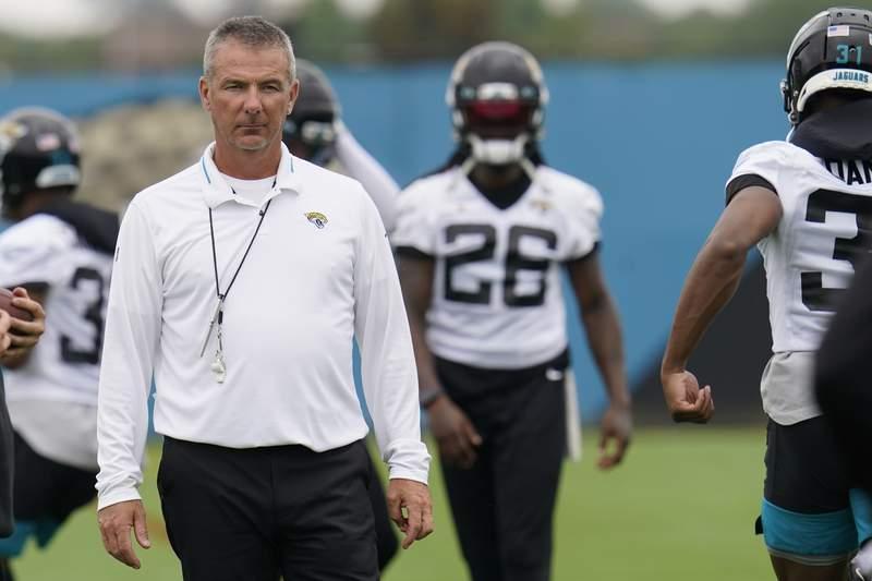 Jacksonville Jaguars head coach Urban Meyer, left, watches players perform drills during an NFL football practice, Monday, June 14, 2021, in Jacksonville, Fla. (AP Photo/John Raoux)