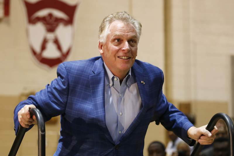 FILE - In this March 1, 2020 file photo former Virginia Gov. Terry McAuliffe walks up to the stage as he prepares to introduce Democratic presidential candidate former Vice President Joe Biden, during a campaign rally in Norfolk, Va.  An unusually broad field is vying to be the next governor of Virginia as the marquee political contest of 2021 gets into full swing. (AP Photo/Steve Helber, File)