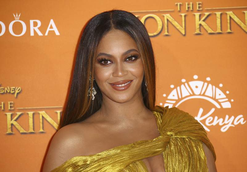 """FILE - This July 14, 2019 file photo shows Beyonce at the """"Lion King"""" premiere in London. YouTube announced Tuesday that Beyonc will deliver an inspirational message to the 2020 class for its Dear Class of 2020"""" event, which will take place June 6 at 3 p.m. EDT and will stream on YouTube. (Photo by Joel C Ryan/Invision/AP, File)"""