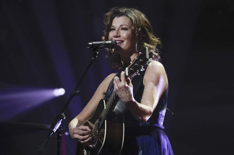 """FILE - In this Oct. 15, 2019 file photo, singer Amy Grant performs during the Dove Awards in Nashville, Tenn. Grant has had open heart surgery to fix a heart condition she has had since birth. A publicist for the singer said doctors discovered the condition during a routine checkup. Grant is married to country singer Vince Gill and is a six-time Grammy winner with hits like Baby, Baby, and That's What Love is For."""" (AP Photo/Mark Humphrey, File)"""