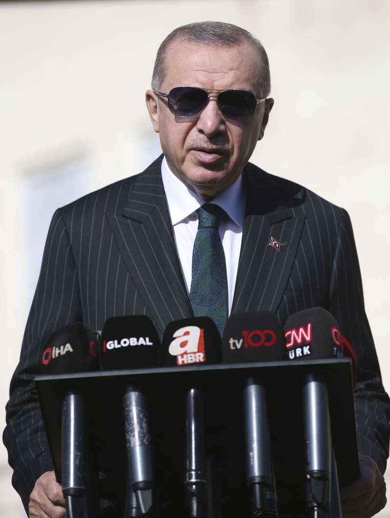 Turkey's President Recep Tayyip Erdogan speaks to the media, in Istanbul, Friday, Oct. 23, 2020. Erdogan confirmed the country tested its Russian-made missile defense system, despite objections from the United States. Speaking after Friday prayers in Istanbul, President Recep Tayyip Erdogan said Turkey had every right to test its equipment. (Turkish Presidency via AP, Pool)