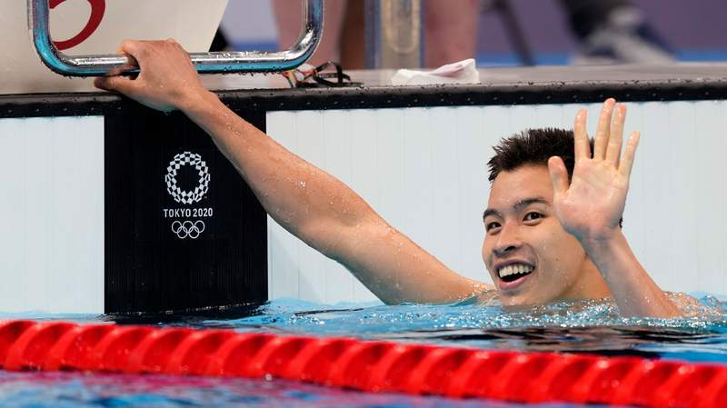 Ian Ho of Hong Kong waves after his heat of the men's 100-meter freestyle at the 2020 Summer Olympics, Tuesday, July 27, 2021, in Tokyo, Japan. (AP Photo/Martin Meissner)