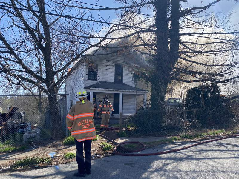 Crews are working to put out a fire at an abandoned home in Southeast Roanoke
