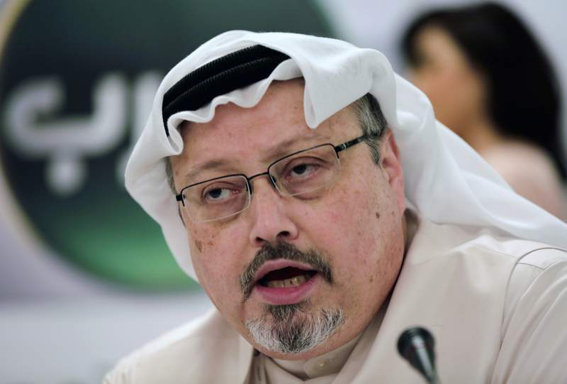 FILE - In this Dec. 15, 2014 file photo, Saudi journalist Jamal Khashoggi speaks during a press conference in Manama, Bahrain. Three leading international NGOs say they're boycotting meetings Saudi Arabia is holding with civil society groups ahead of hosting this year's Group of 20 summit. Transparency International, Amnesty International and CIVICUS said Monday, Jan. 13, 2020 that participating would lend legitimacy to a kingdom trying to whitewash its dire human rights record. (AP Photo/Hasan Jamali, File)