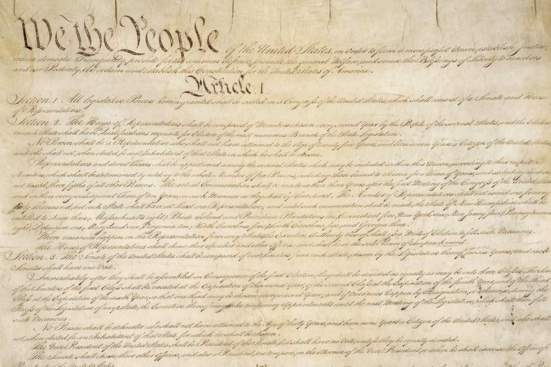 This photo made available by the U.S. National Archives shows a portion of the first page of the United States Constitution. According to NPD BookScan, which tracks around 85 percent of the print market, more than 1 million copies of the Constitution in various editions were sold since Trump took office. The sales are especially notable because the Constitution can be read or downloaded for free, including from the U.S. government. (National Archives via AP)