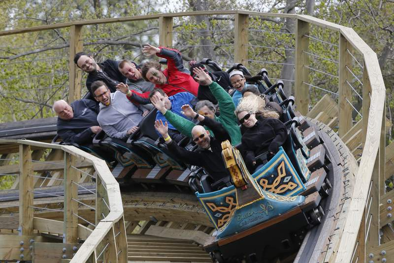 Roller Coaster fans ride the InvadR wooden roller coaster at Busch Gardens in Williamsburg , Va., Friday, April 7, 2017. The coaster is the parks first coaster with wooden tracks. (AP Photo/Steve Helber)