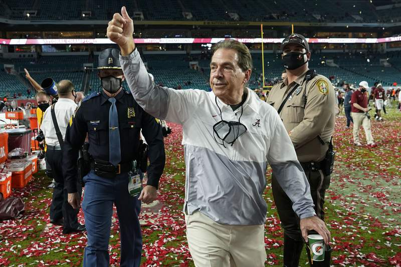 FILE - Alabama head coach Nick Saban leaves the field after their win against Ohio State in an NCAA College Football Playoff national championship game in Miami Gardens, Fla., in this Tuesday, Jan. 12, 2021, file photo. Another college football season will start with everyone chasing the Tide. Alabama is No. 1 in The Associated Press Top 25 preseason college football poll released Monday, Aug. 16, 2021. (AP Photo/Lynne Sladky, File)