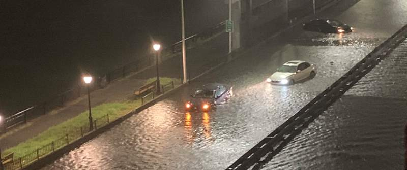 Cars became submerged on roadways due to the intense rain New York City received Wednesday evening.