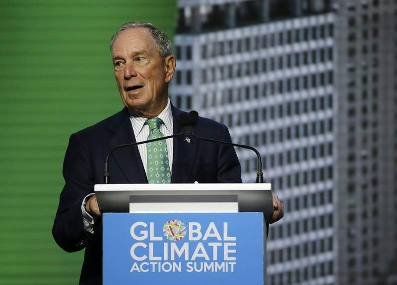 FILE  - In this Thursday, Sept. 13, 2018 file photo, Michael Bloomberg, the UN Secretary-General's Special Envoy for Climate Action, speaks during the plenary session of the Global Action Climate Summit, in San Francisco. The United Nations says American billionaire Michael Bloomberg has been reappointed as a special envoy to engage governments and businesses in tackling the threat of global warming. Bloomberg was first tapped for the position in 2018. The U.N. said Friday, Feb. 5, 2021 that Secretary-General Antonio Guterres wants the former New York City mayor to mobilize stronger and more ambitious climate action in the lead-up to a global climate summit in November. The summit was delayed by a year due to the coronavirus pandemic. (AP Photo/Eric Risberg, File)
