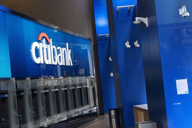 A Citibank office is open, Wednesday, Jan. 13, 2021 in New York.   The nations largest banks are expected to report big profits for the first quarter, Tuesday, April 13,  amid renewed confidence that pandemic-battered consumers and businesses can repay their debts and start borrowing again  (AP Photo/Mark Lennihan)