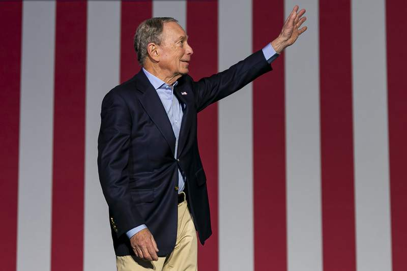 Democratic presidential candidate Mike Bloomberg waves to supporters as he arrives to his campaign rally at the Palm Beach County Convention Center in West Palm Beach, Fla., Tuesday, March 3, 2020. (Matias J. Ocner/Miami Herald via AP)