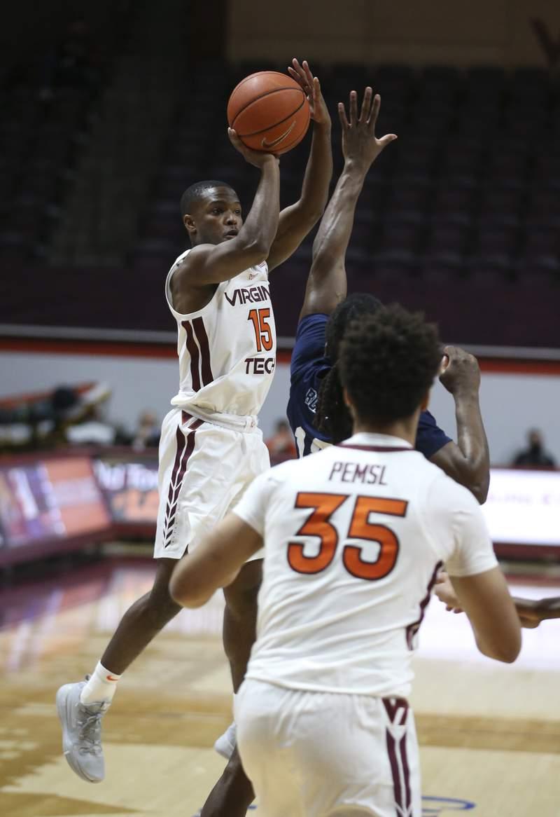 Virginia Tech's Jalen Cone 15 shoots a 3-pint  basket   in the first half of the Longwood - Virginia Tech NCAA basketball game in Blacksburg Va. Monday December 21 2020.  (AP Photo /  MATT GENRTY, The Roanoke Times, Pool)
