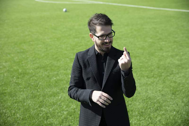 FILE - In this Dec. 27, 2020 file photo, Moshe Hogeg, the owner of Israel's Beitar soccer club, speaks in an interview at the team training ground in Jerusalem. Hogeg, said Thursday, July 15, 2021, that he has called off a friendly with Barcelona over its refusal to hold the match in contested Jerusalem. Israel captured east Jerusalem in the 1967 war, annexed it in a move not recognized internationally, and considers the entire city its capital. The Palestinians seek east Jerusalem as the capital of their future state, and the city's status is one of the thorniest issues in the decades-long conflict. (AP Photo/Ariel Schalit, File)
