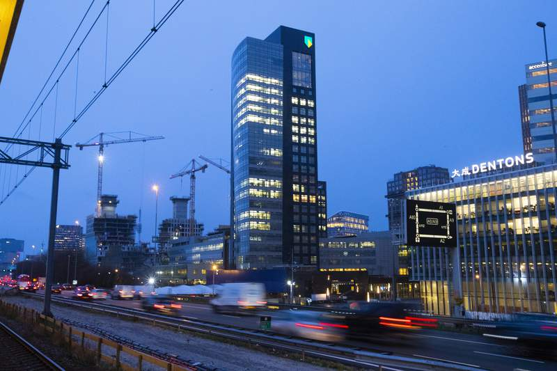 """The ABN AMRO head office is seen in the capital's business district, in Amsterdam, Netherlands, Monday, March 2, 2020. Dutch bank ABN AMRO has agreed to pay 480 million euros ($574 million) as part of a settlement with prosecutors who accused the state-owned bank of """"serious shortcomings"""" in tackling money laundering, prosecutors and the bank said Monday, April 19, 2021. (AP Photo/Peter Dejong)"""