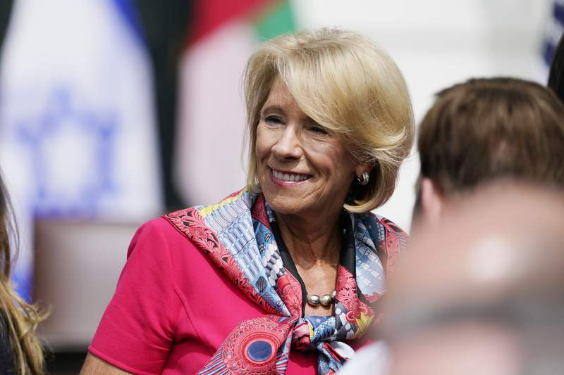 Education Secretary Betsy DeVos arrives on the South Lawn for a ceremony for the signing of the Abraham Accords, Tuesday, Sept. 15, 2020, at the White House in Washington. (AP Photo/Alex Brandon)