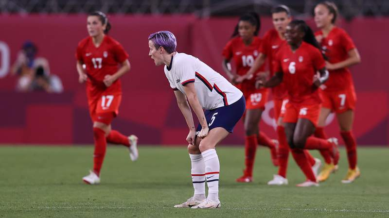Megan Rapinoe of Team USA looks dejected after their side concedes a goal scored by Jessie Fleming of Team Canada on day ten of the Tokyo Olympic Games.