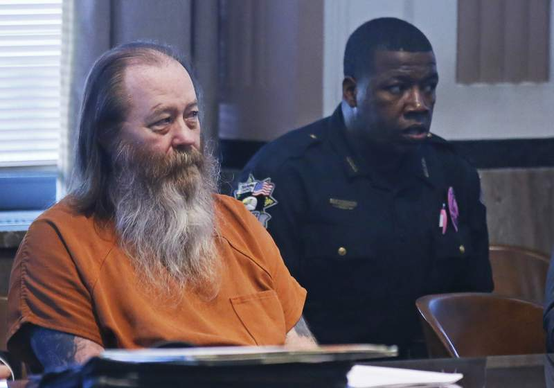 FILE - In this Oct. 18, 2017 file photo, William Lewis Reece, left, waits for a hearing to begin in Oklahoma City. Jury selection began Monday, May 10, 2021, in the death penalty trial of  Reece, an alleged serial killer accused of kidnapping and killing an Oklahoma woman more than 20 years ago. Oklahoma County prosecutors are seeking the death penalty. (AP Photo/Sue Ogrocki, File)