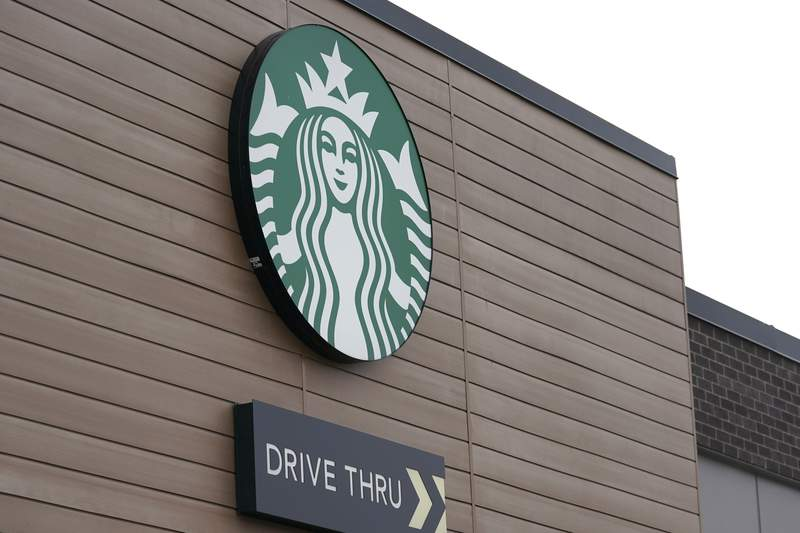 FILE - This Oct. 27, 2020, file photo shows a sign at a Starbucks Coffee store in south Seattle. Starbucks said Monday, Nov. 2, 2020, it plans to open an outlet in Laos as it expands its more than 10,000 stores in Asian countries. The company said it plans to open the shop in the Laotian capital Vientiane by next summer. (AP Photo/Ted S. Warren, File)