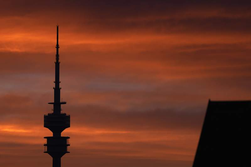 The Olympic TV tower is silhouetted as the sun sets in Munich, Germany, Monday, May 24, 2021. (AP Photo/Matthias Schrader