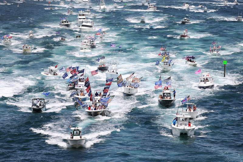 WEST PALM BEACH, FLORIDA - SEPTEMBER 07: Boaters show their support for President Donald Trump during a parade down the Intracoastal Waterway to just off the shore of President Trump's home at Mar-a-Lago on September 07, 2020 in West Palm Beach, Florida. (Photo by Joe Raedle/Getty Images)