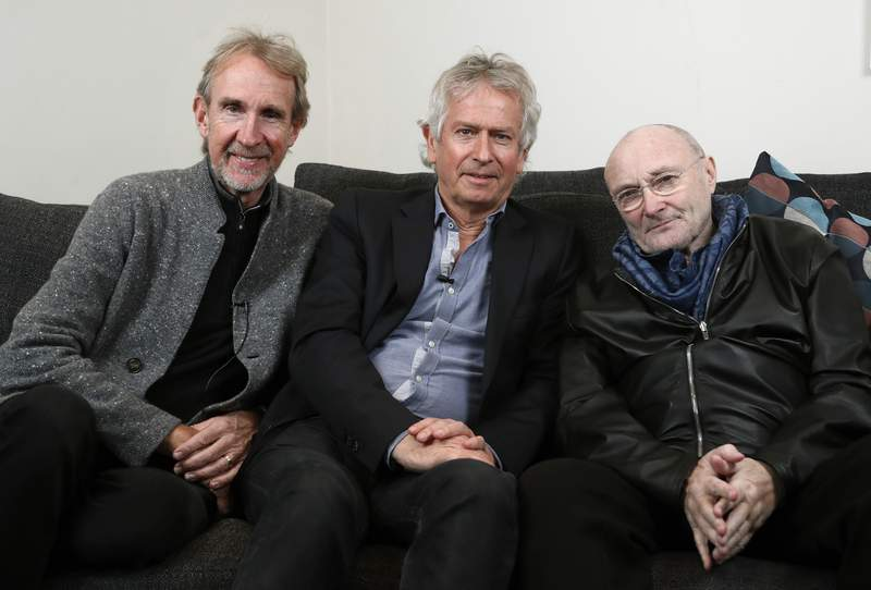 FILE - In this March 4, 2020 file photo, Genesis band members from left, Mike Rutherford, Tony Banks, and Phil Collins pose for a photo during an interview in London. The English rock band is returning to the U.S. for their first tour in 14 years. The trio announced The Last Domino? Tour on Thursday, April 29, 2021, which will kick off in Chicago on Nov. 15.  (AP Photo/Frank Augstein, File)