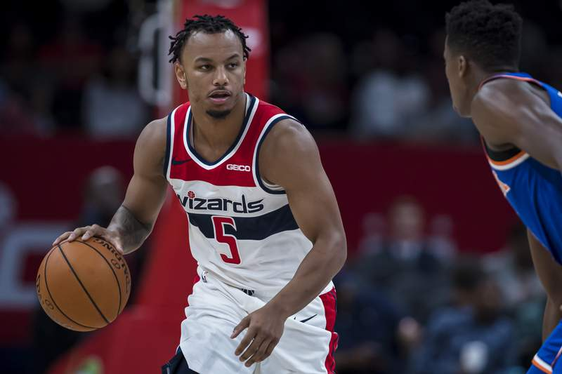 WASHINGTON, DC - OCTOBER 07: Justin Robinson #5 of the Washington Wizards dribbles the ball against the New York Knicks during the second half at Capital One Arena on October 7, 2019 in Washington, DC. (Photo by Scott Taetsch/Getty Images)