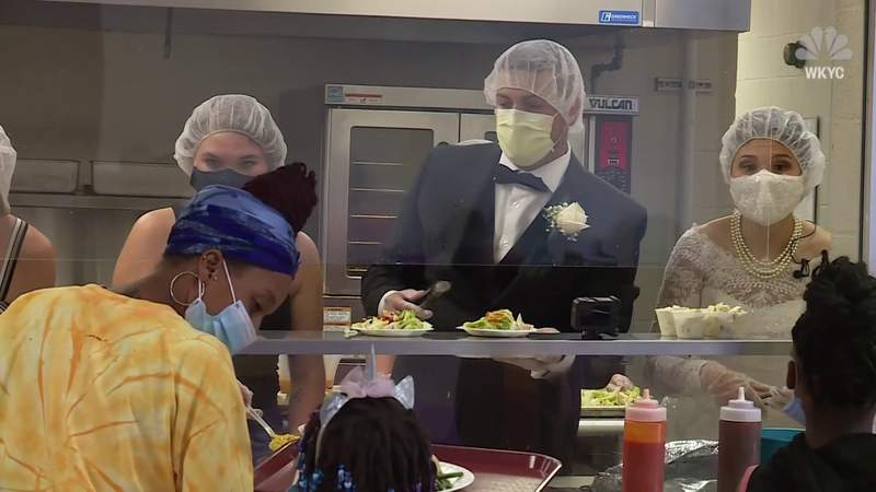 Newlyweds donate and serve their reception food to women and children's shelter