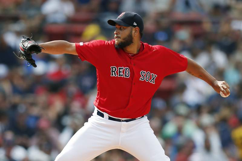 FILE - In this July 27, 2019, file photo, Boston Red Sox's Eduardo Rodriguez pitches during the first inning of a baseball game against the New York Yankees in Boston. (AP Photo/Michael Dwyer, File)