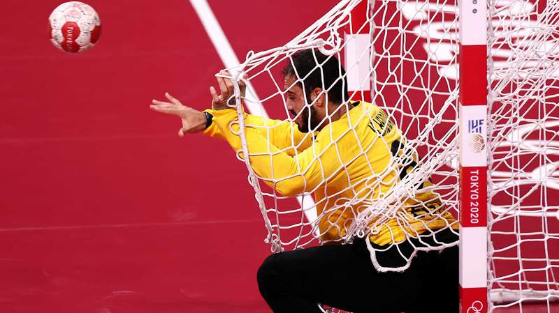 Egyptian goalkeeper Karim Hendawy passes while tangled in his own net Saturday,